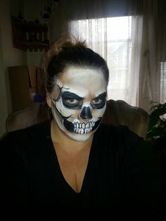 Skull Face paint designed by Amanda Campbell of Shear Bliss Creations. You can find them on FB.