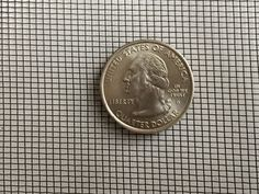 A coin on the black aluminum window screen for contrast. Aluminum Screen, Security Screen, Quarter Dollar, Aluminium Windows, Window Screens, Mesh Screen, How To Attract Customers, Wooden Case, Aluminium Alloy
