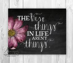 The Best Things in Life arent Things typographic quote with watercolor flower and chalkboard style background ** design is a paper print, styled to