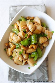 Cashew Chicken. Learn how to use baking soda to make chicken silky, tender ala Chinese restaurant. #chinesefood #recipe