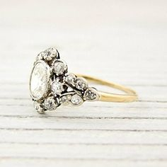 The way the small diamonds encircle the big one. | 40 Vintage Wedding Ring Details That Are Utterly To Die For