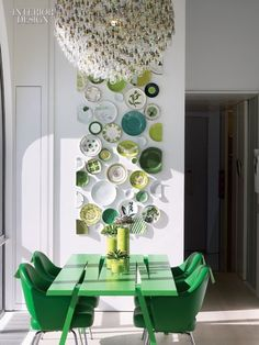 interior design magazine, green Modern dining set with awesome chandelier and funky plate arrangement.