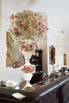 Floral + Crystal Arrangement on Wedding Bar | Photography: Brett Matthews Photography. Read More:  http://www.insideweddings.com/weddings/regal-outdoor-ceremony-ballroom-reception-at-oheka-castle-in-ny/821/
