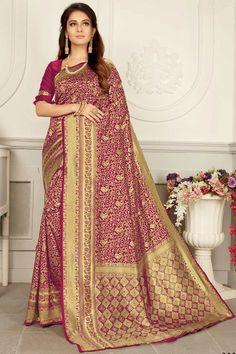 Magenta banarasi silk saree with magenta silk blouse. Embellished with Woven zari work. Saree with Round Neck, Half Sleeve. It comes with unstitch blouse, it can be stitched to 32 to 58 sizes. #magenta #banarasi silk #saree #blouse #Andaazfashion #UK