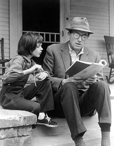 """Gregory Peck (who played Atticus Finch) sits on the porch & reads to Mary Badham, (the girl who played 'Scout' in the 1962 film """"To Kill a Mockingbird"""", based on the book of the same title by Harper Lee). Atticus Finch, Harper Lee, Mary Badham, Gregory Peck, Old Movies, Great Movies, Plane Movies, Famous Movies, Hollywood Actresses"""