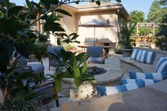 Mediterranean Courtyard | Buff Flagstone and Prairie Gold Capstone | Custom Gas Fire Pit | Denver, Colorado | by Prolithic Designs