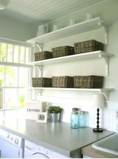 Washing room...love the counter over the machines and shelves above. Washing rooms are always so dark- love the natural light