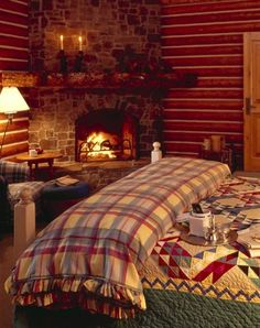 Bedroom with fireplace.  Now if I could just get my cabin to look this cozy...