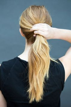 "Brush hair back into a low pony just above the nape of your neck. ""To get more body, split your hair into two and braid two loose pigtails before bed so that the hair isn't too straight and work in  TRESemmé Extra-Firm Control Mousse,"" says Peña."