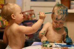 Two completely different styles of art going on here; one artist prefers canvas and the other shows a clear  preference for a much hairier, more mobile  painting surface.  Both display great form and potential.  [Photo from Megaphoto on Facebook.] #toddlers #babies #kids #art #artist