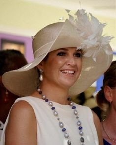 Dutch Queen Maxima's decorative straw hat details as she visit Curacao.