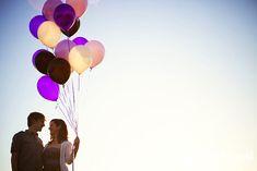 Purple balloon engagement photo session.