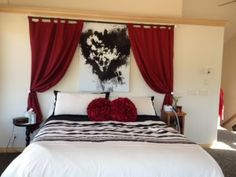 Love curtains above bed! (That's probably one of the Love is Art paintings)