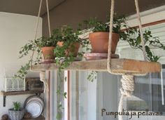 Lovely way to add an herb garden to a kitchen - a little rustic for my taste, but cute!