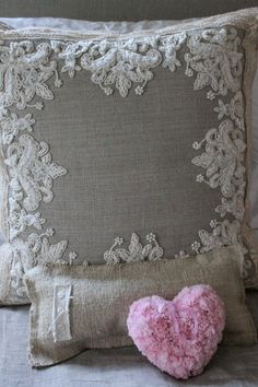 Whimsical heart tossed on a bed with burlap and lace linens