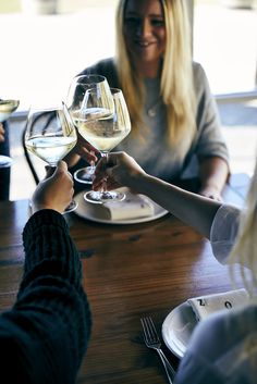 Cheers with a glass of Zonzo Estate Wine