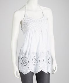 With its lovely crocheted details and flirty halter silhouette, this pretty piece is bursting with breezy, feminine charm. Breathable cotton crafts a cool, comfy look.