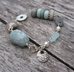 Gorgeous design from Kelly Morgan (KJ)  using my faux carved beach glass and beach cairn spacers....<3 This has to be one of my favorite designs using my beads EVA...
