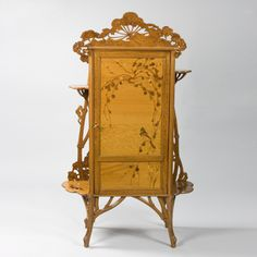 """French Art Nouveau """"Japonisme"""" Cabinet by Gallé decorated in marquetry with an inlaid bird and foliage, carved ombelle flowers and stems.  From the private collection of Barbara Streisand.  Circa 1900"""