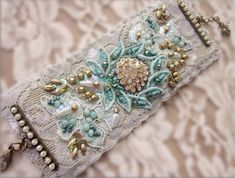 Aqua/Gold Lace Cuff by MagicalMysteryTuca on Etsy Lace Jewelry, Textile Jewelry, Fabric Jewelry, Jewelry Crafts, Jewelery, Fabric Bracelets, Lace Bracelet, Handmade Bracelets, Handmade Jewelry