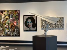 Beautiful #painting of Liz Taylor, #dollar #sculpture on the wall, #giant #painting and an #amazing #aviator with his #paperplane Paper Plane, Pop Art, Art Gallery, Ceiling Lights, Sculpture, Amazing, Wall, Painting, Beautiful