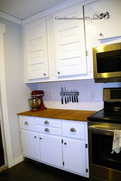 Using one of my grandma's old cabinets and a set of her old cabinet doors in our brand new kitchen with new paint and new hardware! Country kitchen!
