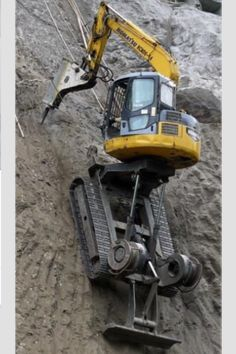 Mountain climbing JCB , no namby pamby safety gear required either by this macho machine