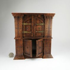 http://www.ebay.com/itm/NICE-Miniature-Dollhouse-Gothic-Cabinet-Or-Medieval-Cabinet-For-A-Hobbit-OOAK-/281116591412?pt=US_Dolls_Bears_Toys=item4173dac534