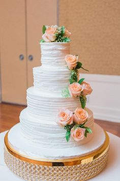 White wedding cake, classic, peach roses, glass balls & gold cake stand // Thompson Photography Group