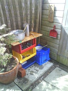 outdoor play kitchen.... loved how they used the bins underneath for storage.