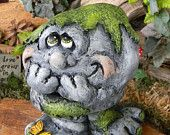 Rock, the peeping  like a possum garden statue... Moss Rock with mossy feet and butterfly no evil stones