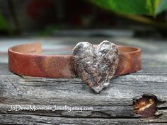 Rustic heart cuff bracelet in sterling silver and copper $75. by JoDeneMoneuseJewelry