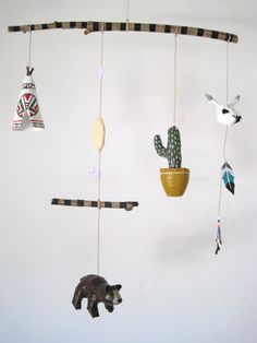 Pseudo Navajo Mobile:  includes a teepee, harvest moon with amethyst stars, brown bear, potted cactus, steer skull and two dream feathers.  This mobile is