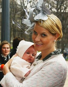In 2004, Crown Princess Mette-Marit of Norway, held Princess Ingrid Alexandra as they arrived at the baby's christening.