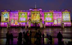 Diamond Jubilee: Self-portraits by 200,000 children are projected onto Buckingham Palace to form pictures of the Queen