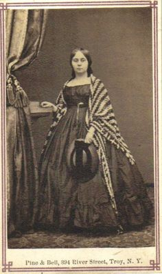 1860s Troy NY c-d-v, young woman with striped knitted or crocheted shawl.  Nice example of hat of the period too.