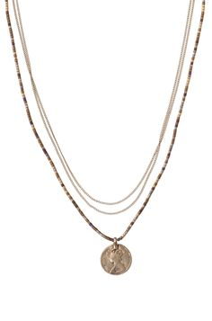 Love this vintage coin pendant