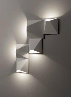 Wandlampe Mats klein 4564 von Egoluce   Wandleuchtensystem mit COB LED-Modulen. Körper aus lackiertem Metall, erhältlich in zwei Größen. Ausführungen: weiß, schwarz und sand.   Zubehör zur...