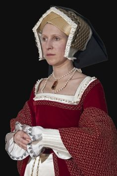 The outfit made according to a portrait of 3rd Henry VIII's wife Jane Seymour by Hans Holbein, 1537 (The royal picture gallery Mauritshuis, Haag). The outfit is hand-sewn by linen and silk thread according to patterns in the book The Tudor Tailor, even if some methods were fitted to the portrait. The dress is made of 11 meters of half-silk velvet and consists of the dress with the train and turn-back sleeves and separate stomacher, which is pinned over the front lacing of dress. Brass pins…