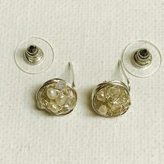 Made a pair is silver crochet wire freshwater pearl and crystal stud earrings!