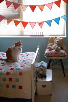 love this quilt...want to make one like this with the girls' baby clothes
