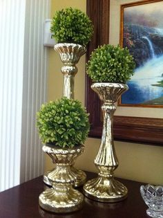 Simple boxwood orbs on candlesticks.....