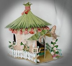 I love the grass thatching on this paper house