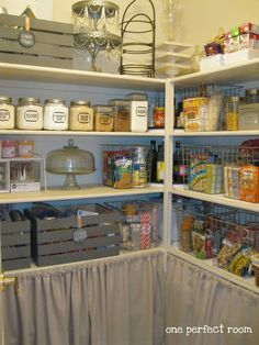 Curtained Shelves In  Pantry - great idea! Cover up all of the extra staples you stock up on.