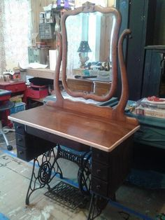 Singer sewing machine base repurposed as vanity
