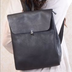 This genuine leather bag is crafted from top grain cowhide. The characteristics of the leather are soft and durable. Rather than wearing out, it will develop a patina during its expected useful lifetime. This highly functional bag is designed to tote everything from clothing to a laptop. It is ideal for storing everything such as a jacket, a laptop (up to 11'') or a few magazines. This simple, practical bag is an ideal gift for any women, young or old. This utilitarian bag is a dura...