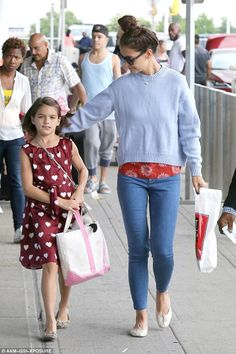 Proud mom: The 37-year-old actress cast a proud look upon her 10-year-old girl