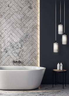 Um banheiro clean, moderno e muito elegante. Aqui podemos observar como esta combinação de cores se complementam bem: banheira off-white, a textura clara no fundo, uma parede com cor mais pesada e o Pendente Primus com lâmpada branca, deixando tudo mais harmonioso e lindo.