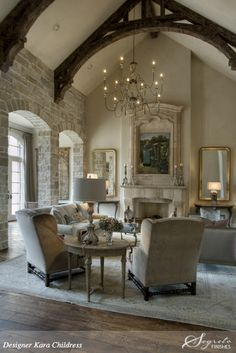 architectural ceiling, chandelier, stone walls & fireplace