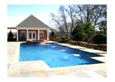 Pool Houses | Brick pool house with spa, swimming pool, and laminar water jets. Full ...